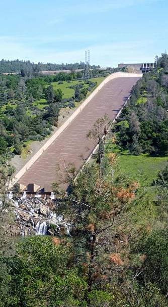 Oroville dam spillway flowing for first time in years